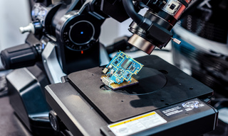 The electronic board is checked using an electron microscope