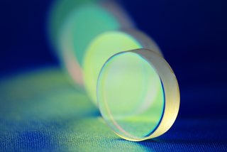 laser industry optical components ; flat thick mirrors with special reflection coating used in Laboratory Science and in Laser Manufacture, macro-image sharp focus is on the front mirror center